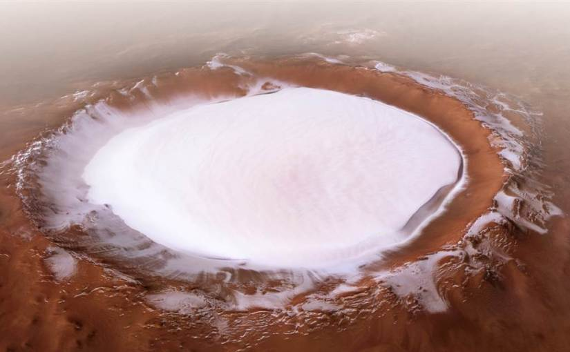 This ice-filled crater on Mars looks like a huge alien skating rink