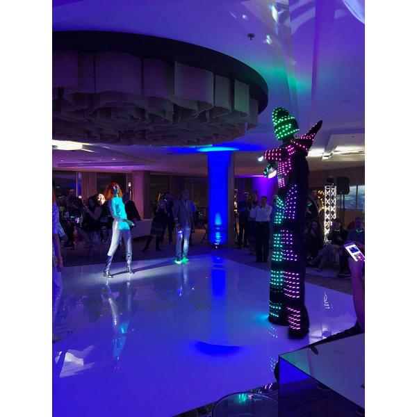 """The annual Lighting After Dark industry party was full of theatrics, including an """"LED stilt man"""" who mingled during the party and posed for pictures."""
