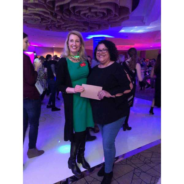 Quoizel's Debbie Miranda (right) won the $500 gift card giveaway during Lighting After Dark. Dallas Market Center's Laura Van Zeyl presented it