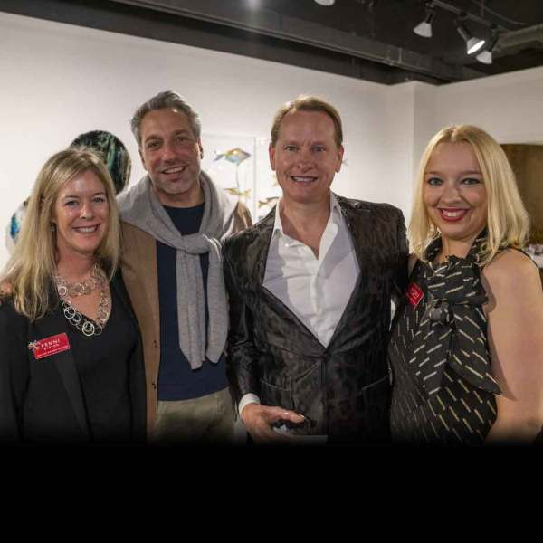 Dallas Market Center's Penni Barton (left) and Nicole Garrison (right) flank Thom Filicia and Carson Kressley, the hosts of the ARTS Awards, during the ARTS Preview Party