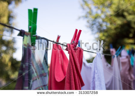 stock-photo-drying-colorful-clothes-outside-313307258