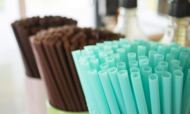 Drinks straws in container in cafe