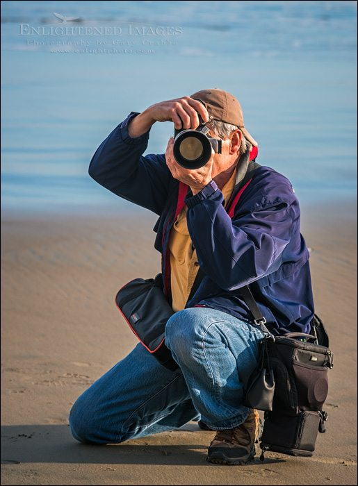 Photographer at work on the beach at Point Reyes National Seashore, Marin County, California