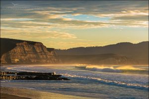 Photo: Sunrise light on the coast and cliffs above Drakes Beach, Point Reyes National Seashore, Marin County, California