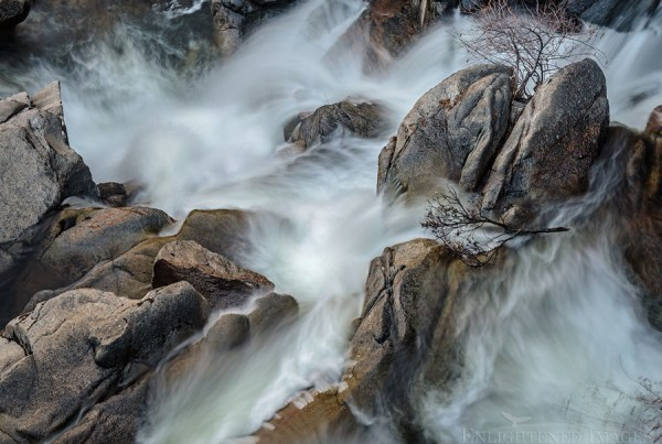 Photo: Water flowing over granite rocks in Cascade Creek, Yosemite National Park, California