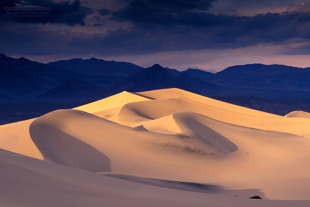 Photo: Storm clouds over star sand dunes and mountains at sunset, Stovepipe Wells, Death Valley National Park, California