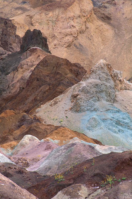 Photo: Exposed colorful mineral deposits on eroded hillside, Artists Palette, Black Mountains, Death Valley, California
