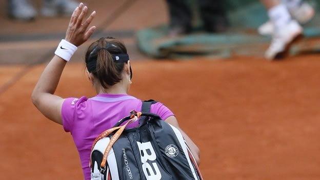 La china Na Li se despidió del Roland Garros 2014 en su partido debut.