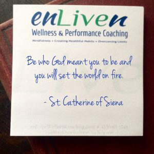 "Enliven Wellness Coaching sticky note with Saint Catherine of Siena quote, ""Be who God meant you to be and you will set the world on fire."""