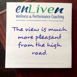 "Quote on enliven wellness coaching and counseling sticky note reading, ""The view is much more pleasant from the high road."""