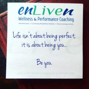 "Quote on enLiven Wellness Coaching sticky note. ""Life isn't about being perfect, it's about being you. Be you."""