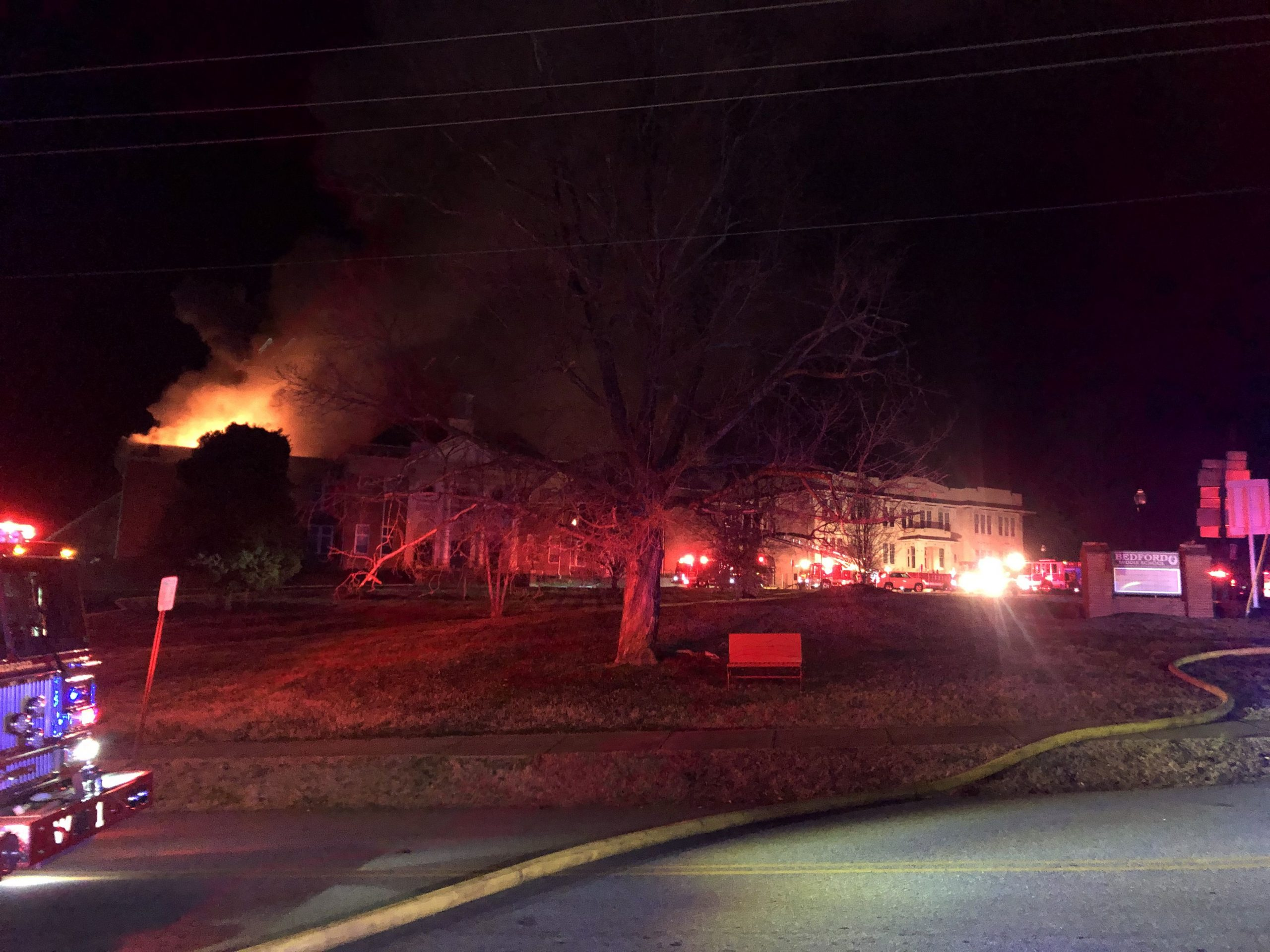 Crews are on the scene of a fire at the old Bedford Middle School