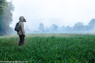 fights about the eviction of barricades on 26/04/2018. Zadist with gas mask standing on an open field. air still filled with big amounts of tear gas fired by the military police to secure their retreat