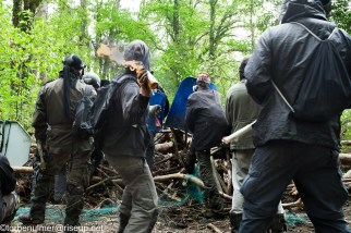 fights about the eviction of barricades on 27/04/2018. Zadist throwing a molotov cocktail at the gendarmerie behing a barricade in the forest