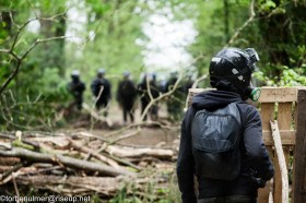 fights about the eviction of barricades on 27/04/2018. Zadist wearing helmet and gas mask standing behind a barricade in the forest