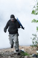 fights about the eviction of barricades on 27/04/2018. Zadist running away from a heavy cloud of tear gas, carrying a improvised shield