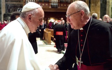 Pope Francis greets Bishop Kevin J. Farrell of Dallas in Washington in September 2015. Pope Francis has named the Texas bishop to head the Vatican's new office for laity, family and life. (CNS photo/courtesy The Texas Catholic) See VATICAN-FAMILY-APPOINTMENTS Aug. 17, 2016.