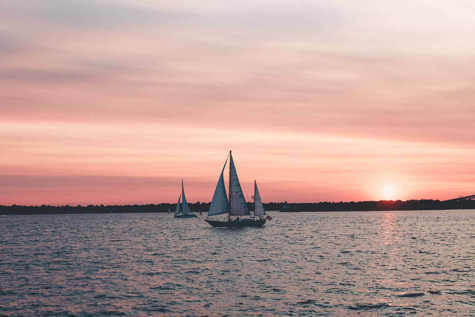 two white sailboats on body of water