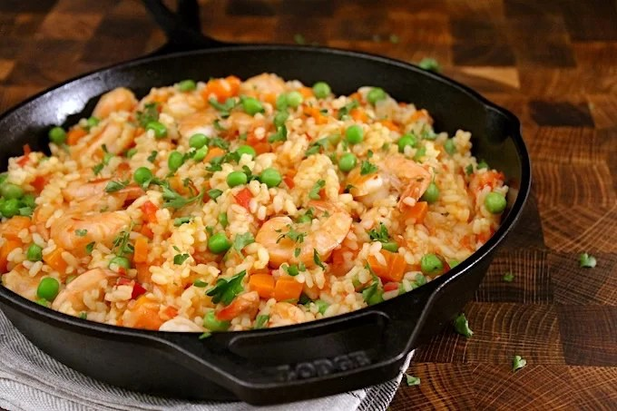 rice with shrimp on a cast iron pan