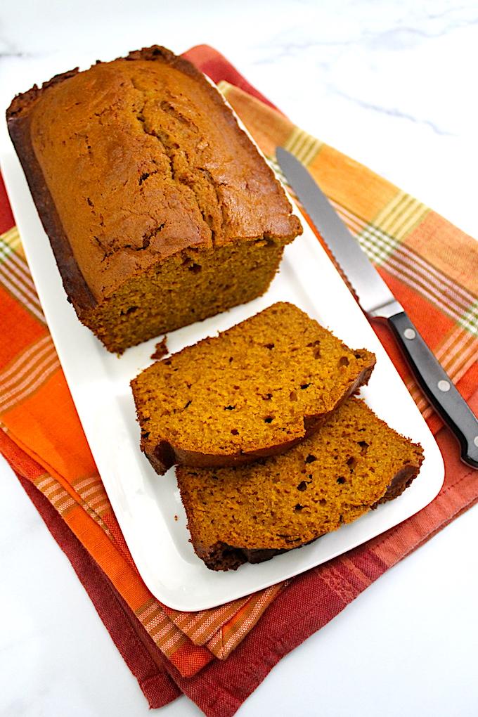 sliced pumpkin-spice bread with orange zest