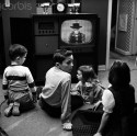 1956, Philadelphia, Pennsylvania, USA --- Kids and Television Console --- Image by © Genevieve Naylor/Corbis