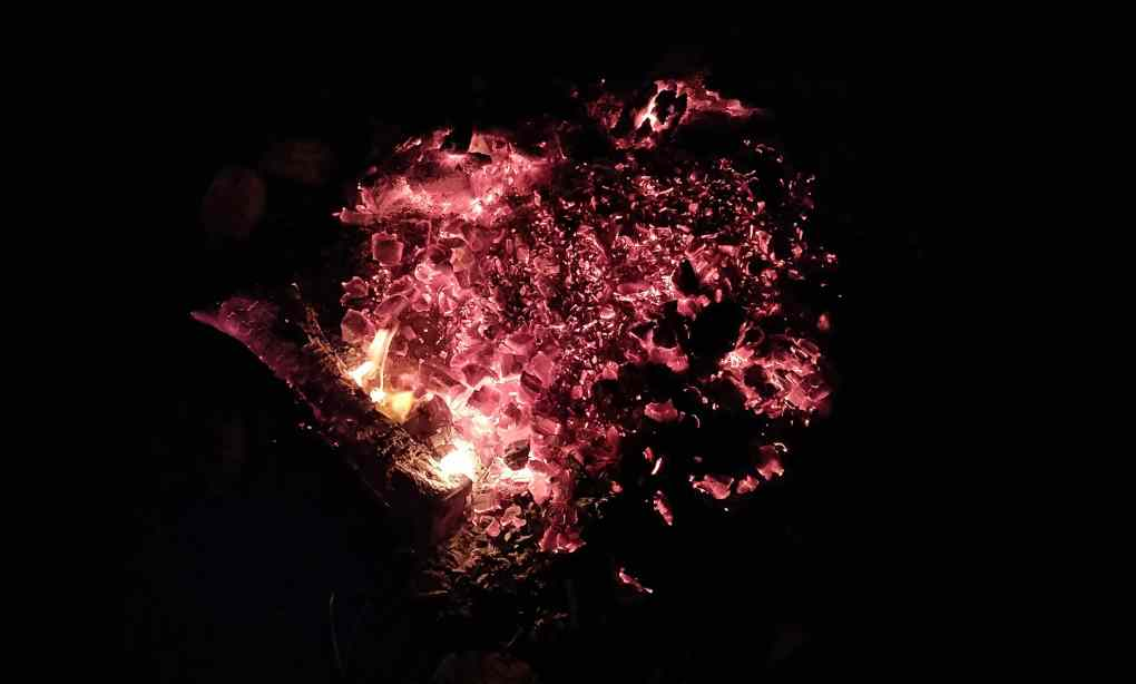 Embers in a fire pit circled