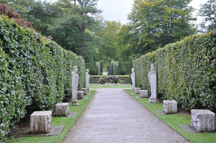Clipped yew hedges with statuary