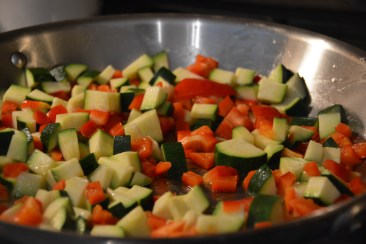 The zucchini and red peppers