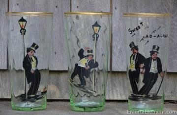 Three of six vintage beer glasses.