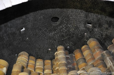 The saggars are stacked to the very top of the bottle oven