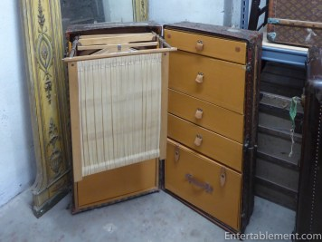 Trunks opened outwards with built in drawers and hanging space