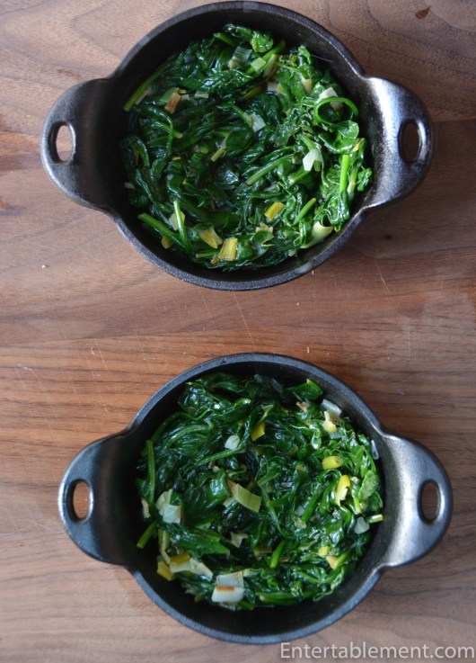 Divide the Spinach between two cast iron skillets