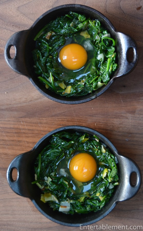 Carefully break the eggs into hollows in the spinach