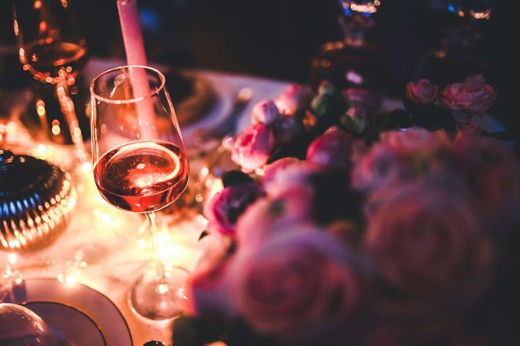 Setting the mood with red roses and red Wine