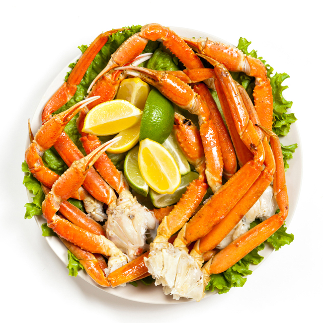 http://www.dreamstime.com/stock-images-crab-legs-snow-fresh-lemon-slices-selective-focus-claw-image38878204