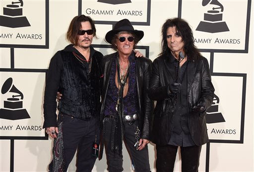 Johnny Depp, from left, Joe Perry, and Alice Cooper of The Hollywood Vampires arrive at the 58th annual Grammy Awards at the Staples Center on Monday, Feb. 15, 2016, in Los Angeles. (Photo by Jordan Strauss/Invision/AP)