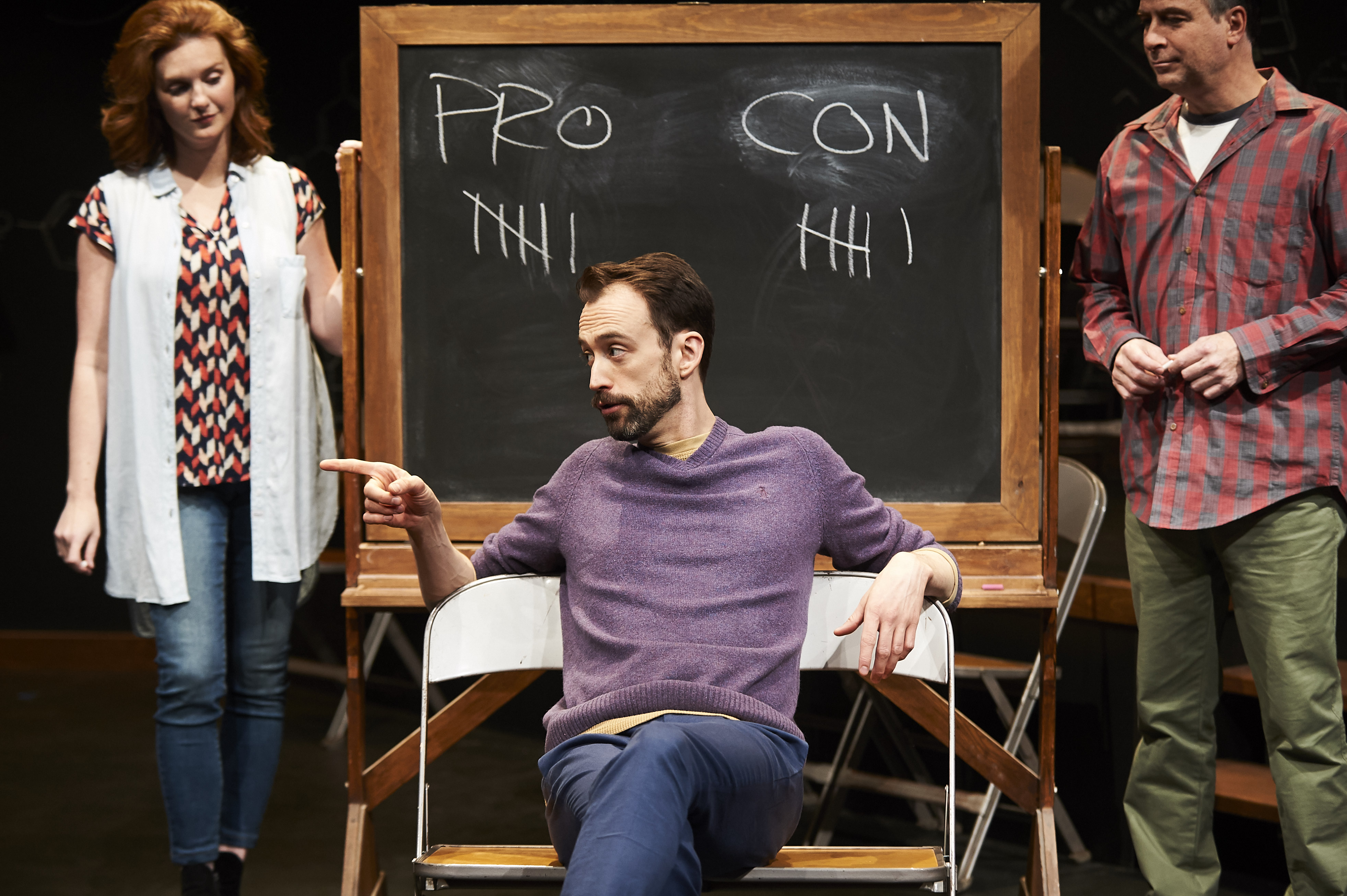 Sean (Kyle Cameron, seated) likes to get insanely, destructively too high. Crazier yet, he figures the costs and benefits balance out, though Daina Michelle Griffith and Daniel Krell don't seem convinced.