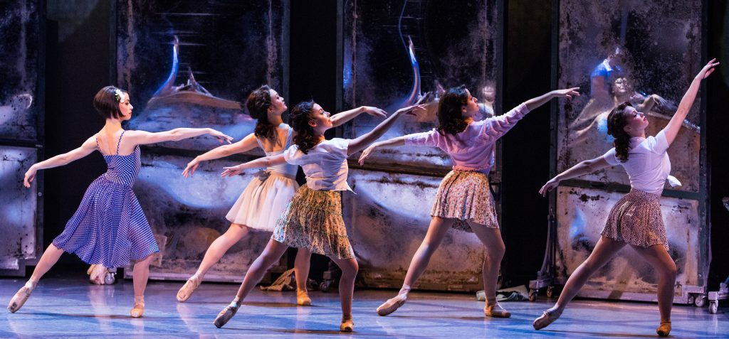Lise (Sarah Esty), far left, auditions for the ballet in front of the large mirrors.