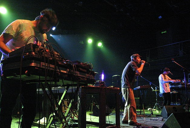 Animal Collective in a 2008 concert (l. to r.) Geologist, Avey Tare, and Panda Bear. photo: adrigu and Wikipedia.