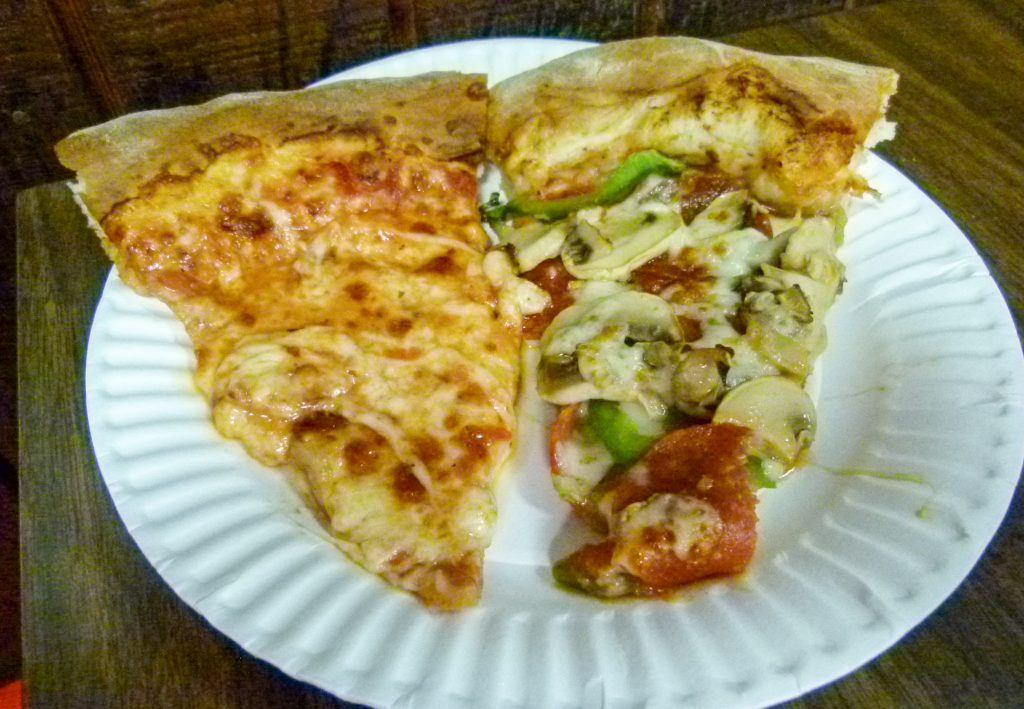 One slice plain, one slice with pepperoni, mushroom, and green peppers.