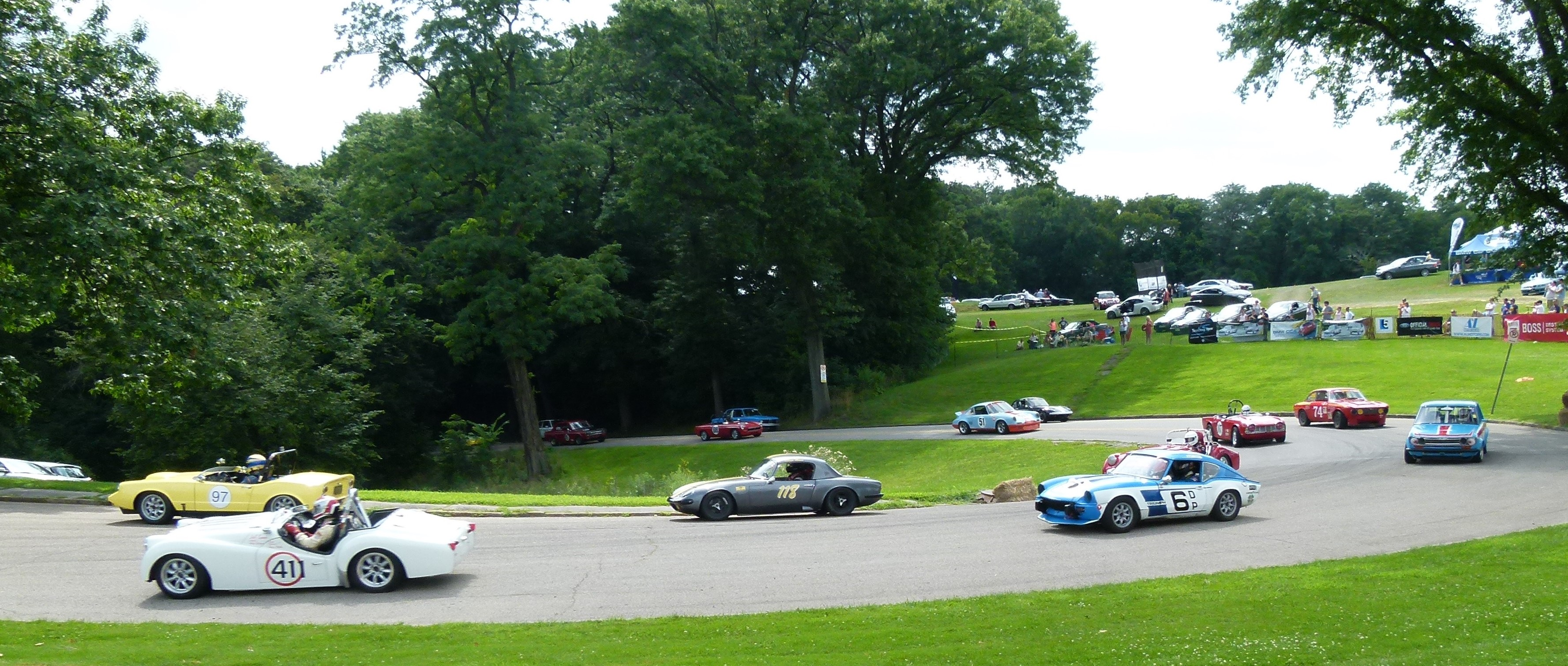 The 97 and 41 cars emerge from the sharp curve.
