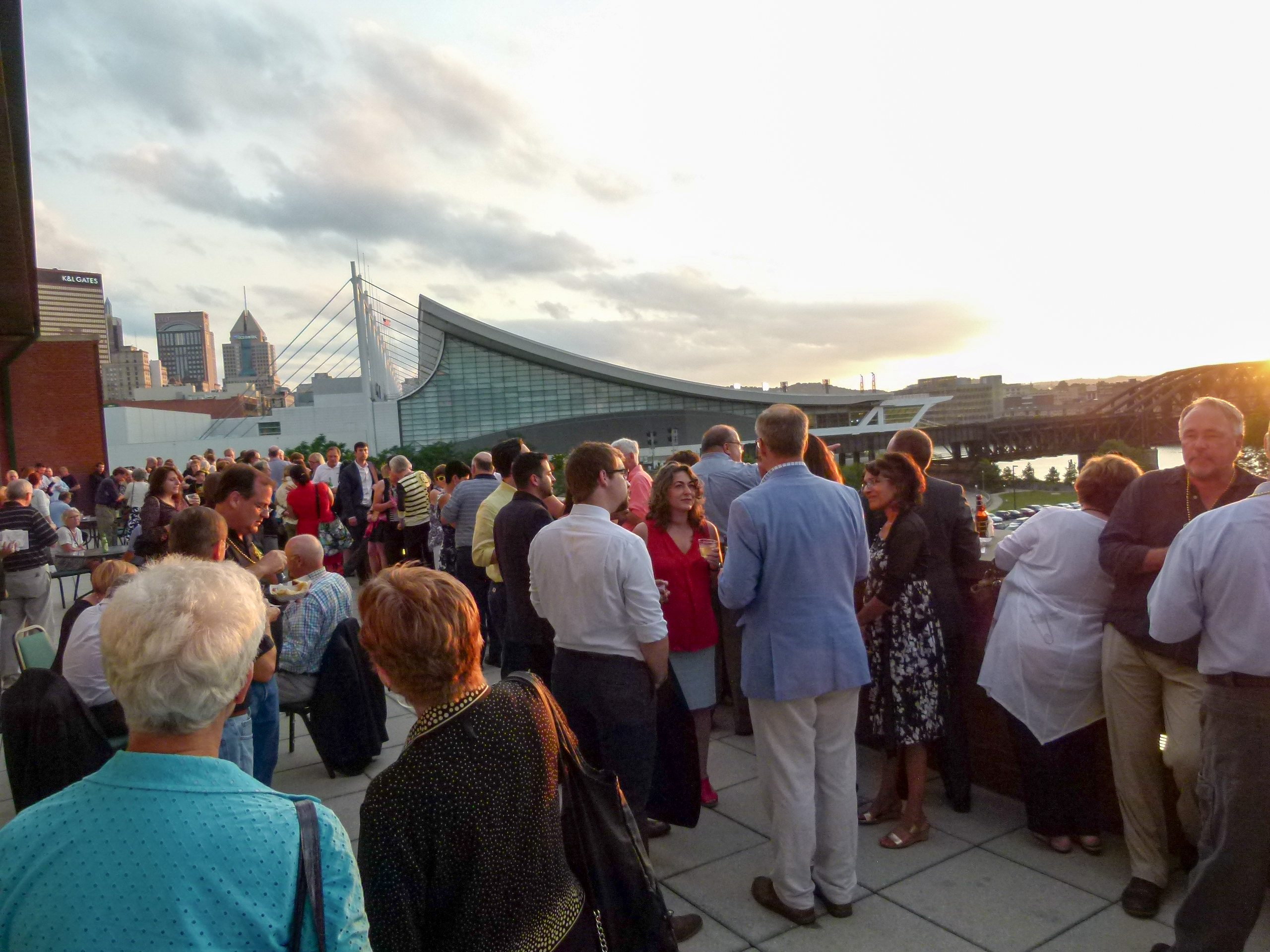 Attendees enjoying a Pittsburgh sunset on the fifth floor deck.