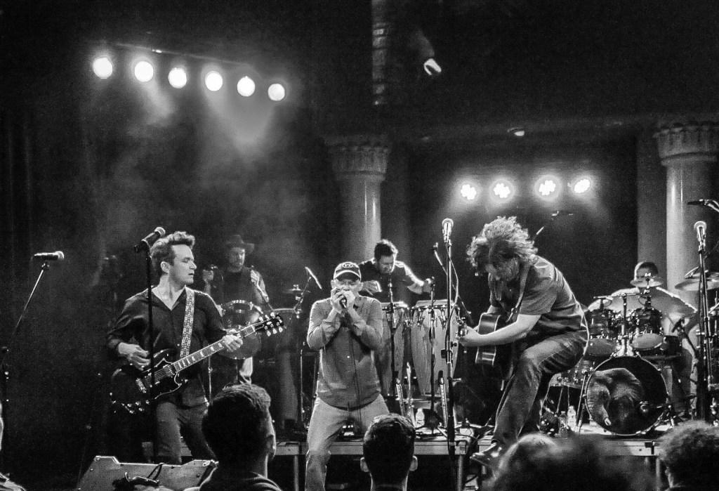 Jim Donvan (jumping guitarist) & Sun King Warriors. Photo: Erica Dilcer.