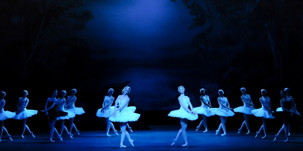 White and back swans dancing together in 'Swan Lake.'