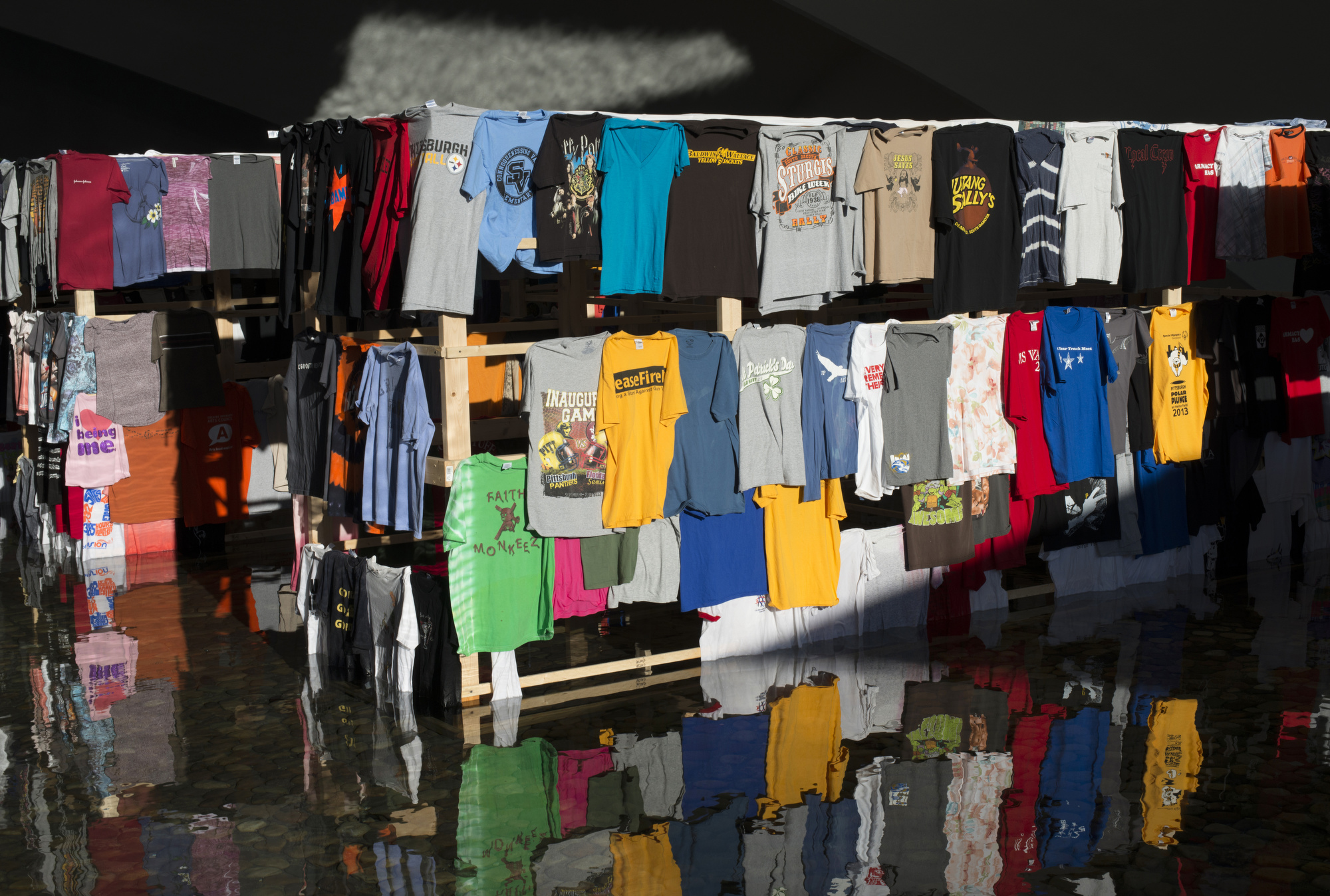 """Edith Abeyta of North Braddock used thousands of recycled T-shirts in her installation """"o:ne:ká,"""" on display beneath the portal bridge in Point State Park."""