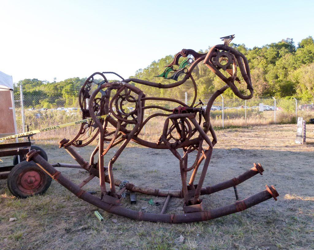An iron art rocking horse.