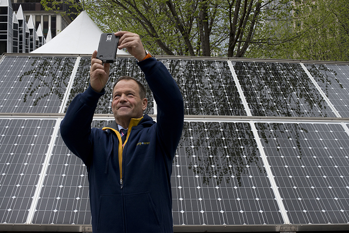 Robert Swan snaps a selfie with the solar panels on display at the EverPower Earth Day Festival. Swan, an advocate for renewable energy and the protection of Antarctica, is the first person to walk to the North and South Poles.