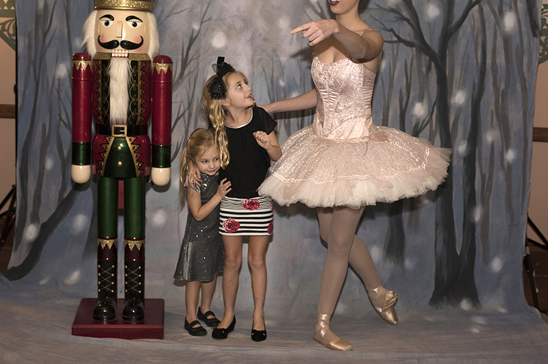 During intermission Scarlett Curtin, 4, and Gianna Curtin, 8, of South Fayette Township, pose with the Nutcracker and a Sugar Plum Fairy in the Benedum Center lobby.