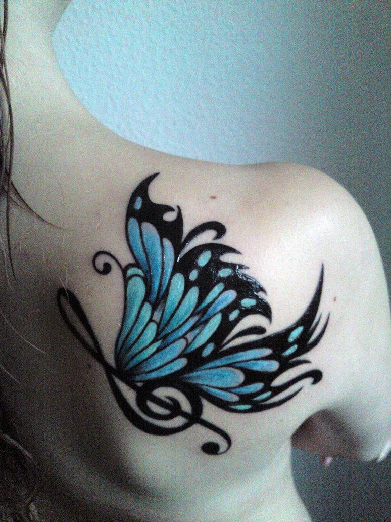 Wings tattoo on back female