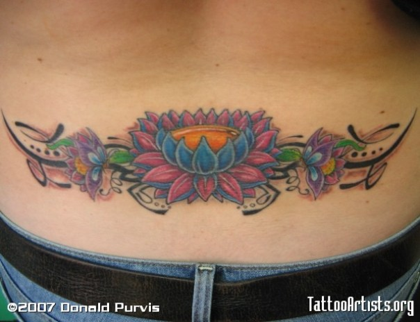 Tribal lotus flower lower back tattoo
